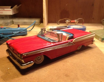 Cragstan 1958 Ford Convertible - Battery operated with retractable top, forward and reverse, 14 inches long