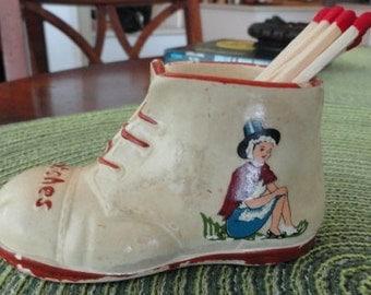 A974)  Vintage Chalkware Match Holder  shoe