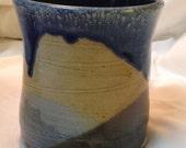Small wheel-thrown vase, stoneware.  Blue, brown, yellow, white.