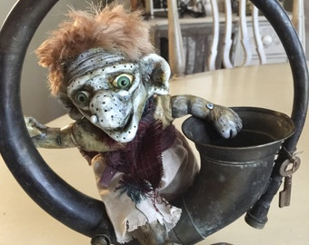 Meet Auger the troll art doll altered baby doll mounted in a vintage horn