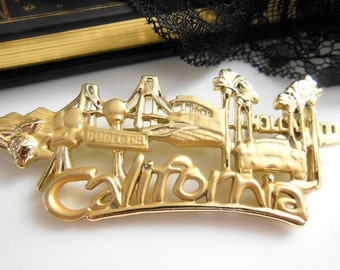 Vintage Danecraft Large Gold Tone California Hollywood Rodeo Drive Brooch Pin
