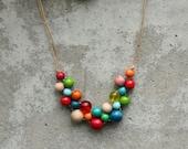 Retro colours, wooden bead necklace, bright, red, aqua, green, orange, bib necklace, contemporary.
