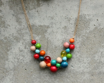 Retro colours, wooden bead necklace, bright, red, aqua, green, orange, bib necklace, contemporary.