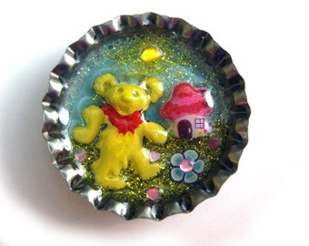 Grateful Dead dancing bear pin, hat pin, handmade and one of a kind, enamelled bear in bottlecap with tiny mushroom house and flowers