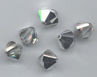Twelve rare vintage Swarovski crystal beads: Art. 5301 - 10 mm - crystal comet argent light