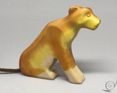 Toy lion mother wooden yellow brown colourful  sitting Size: 12,0 x 10,5 x 2,5 cm (bxhxs)  approx. 87,0 gr.