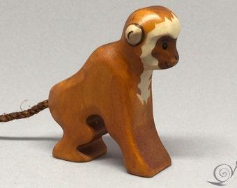 Toy Monkey mother wood lightbrown sitting Size: 6,5 x 6,5 x 2,0 cm (bxhxs) approx. 20,0 gr.