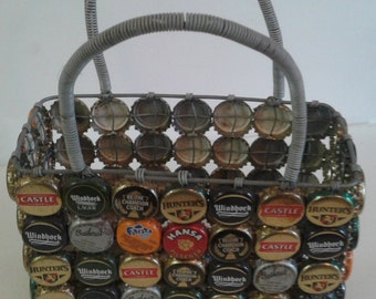 BASKET HOLDER crafted from RECYCLED Beer and Bottle Caps. Hand Made in Africa by a Master Craftsman. Decor item and used for sauce bottles.