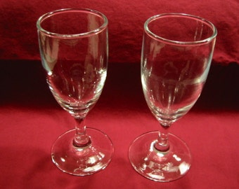"""pair of clear vintage stemmed cordial/aperitif/small dessert wine glasses/small champagne flutes . . 5  3/4"""" tall . . excellent condition"""