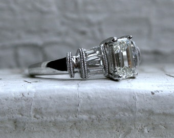 Stunning Vintage Platinum Emerald Cut Diamond Engagement Ring - 1.15ct.
