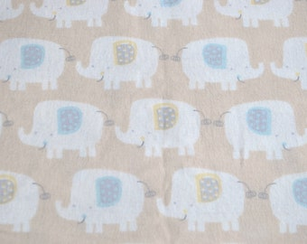 Elephants.  fabric by the yard.  Baby boys.  Cut by the 1/2 yard (18 inches, 45.72 cm).  Brown, blue, yellow.