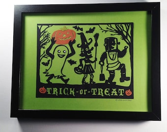 Halloween Night with Trick or Treaters walking. Handmade art work made from paper.