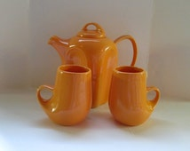 Vintage Ceramic Coffee or Teapot with 2 Matching Cups. Dreamsicle Orange.