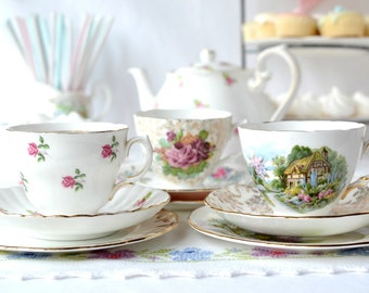 A trio of tea sets, pretty English vintage china trios: 3 mismatched bone china tea cups, saucers and plates