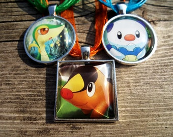 Snivy Oshawott and Tepig Glass Pendant made from trading cards