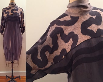 Sophisticated & crafty silk brown tones batik tunic with tie neck