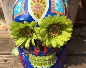Aztec inspired design with flower eyes Dia de los Muertos sugar skull mask.