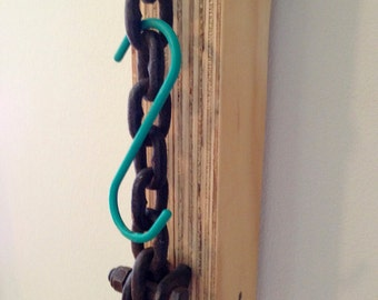 Modern coat hanger.  Chain + Laminate