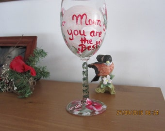 "Wine Glass ""Mom you are the Best"" hand painted with red and white Pansies green leafes and white baby breath"