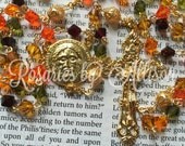 Orange, Olivine, Topaz and Garnet Preciosa bicone and gold Swarovski pearl rosary with gold plated Christ Face center and ornate crucifix