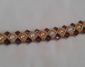 Amber Swarvoski Crystals, yellow pearls, white pearls surrounded by bright gold seed beads