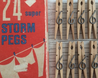 An original mid century vintage packaging with  24 wooden clothes pegs. Bold red 1960s packaging design.
