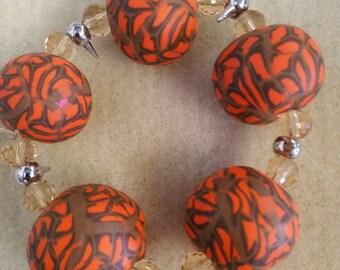 Orange and brow clay bracelet