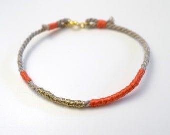 coral et gold color rope bracelet