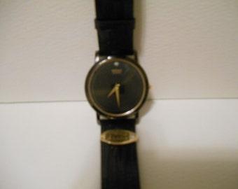 One (1) Seiko, Black Face, Quartz Dress Presentation Watch, with FMC Emblem on Lizard Strap.
