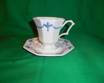 "One (1), 3 5/8"" Footed Tea Cup & Saucer, from Independence, by Castleton China, of Japan, in the Ash Lawn Pattern."