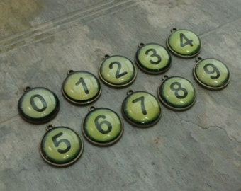 CLEARANCE pkg of (10) - Numbers 0-9 Antiqued Brass finished drops with resin, 20mm