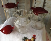 Vintage Syrup Pitchers Clear Depression Glass with Red Metal Spring Lids Cream Server Kitchen Collectible Farmhouse Breakfast
