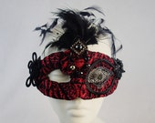 Crimson Creature Masquerade Mask Steampunk Feather Accented Red and Black Brocade Velvet  Half Face Asymetrical Fabric Burlesque Halloween