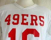 vintage 80's San Franciso SF 49'ers #16 Joe Montana NFL Football white v-neck mesh jersey graphic t-shirt red logo print rawlings large med