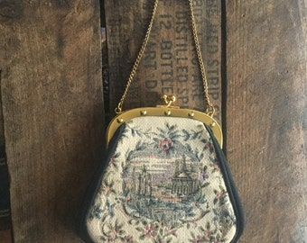 Small needlepoint JR purse with gold chain handle.