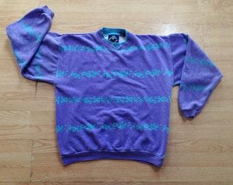 vintage 1980s crew neck sweatshirt with neon geometric design. retro clothing.