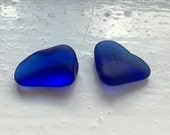 Two blues: A beautiful pair of vibrant blue sea glass bubbles