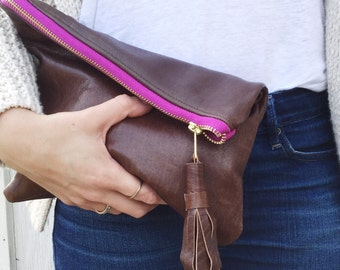 Leather fold over tassel clutch