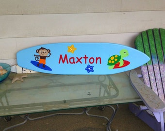 4 foot wood surfboard wall art with surfing monkey and goes with Carter's Laguna Monkey bedding