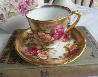 Royal Chelsea Demitasse Cup and Saucer Set in the Golden Rose Pattern Bright Pink and Peach Roses with Heavy Gold Gilt made in England