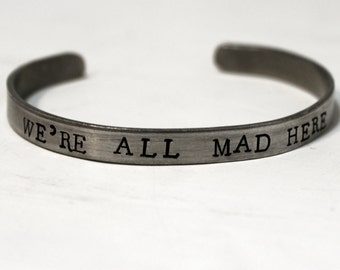 We're All Mad Here Bracelet, Cheshire Cat Quote Mad Hatter Cuff Bracelet, Alice in Wonderland Jewelry, Handstamped Thin Bracelet