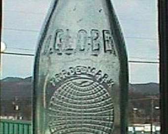 Antique GLOBE Beverages bottle - w/ 3 great embossed pictures of the Globe - LARGE 24 oz. size