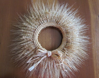 Candle Ring Made of Wheat Heads Decorated with Babies Breath, a Raffia Bow, and a Wheat Stem Flower