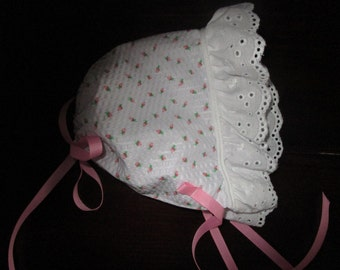Rosette baby or toddler bonnet with eyelet ruffle and pink grosgrain ribbons