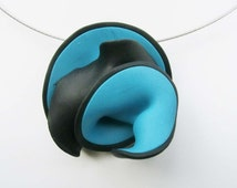 Black blue pendant brooch/ 2 sides 2 colors/ wavy swirly polymer clay shape/ hanging with brooch pin on neck wire/ choose neck wire
