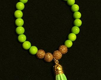 light green & gold tassel