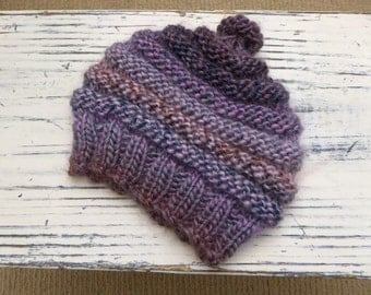 Hand knitted purple coloured baby hat for baby 0-3 months