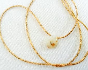 Creamy white Ocean Jasper teardrop pendant on long metallic gold Czech glass necklace, layering thin simple strand