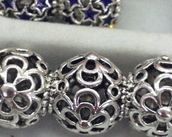 925 Sterling Silver 6 petal flower european type charm with the large hole.