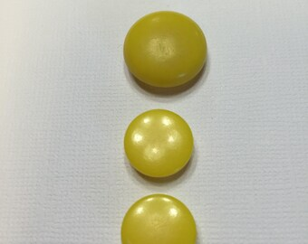 Three bright yellow vintage buttons!